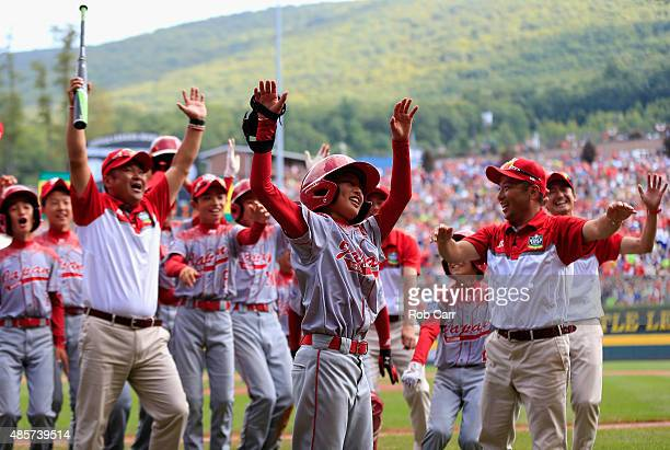 Team Japan celebrates after defeating team Mexico 10 during the International Championship game of the Little League World Series at Lamade Stadium...