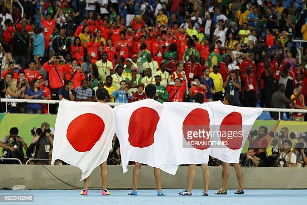 TOPSHOT Team Japan celebrates after finishing second of the Men's 4x100m Relay Final during the athletics event at the Rio 2016 Olympic Games at the...