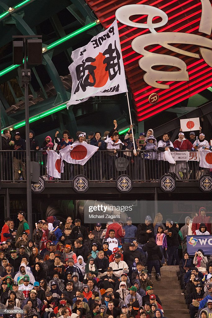Team Japan fans are seen in the outfield during the semi-final game against Team Puerto Rico in the championship round of the 2013 World Baseball Classic on Sunday, March 17, 2013 at AT&T Park in San Francisco, California.