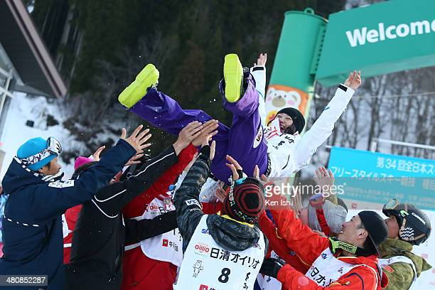 Team Japan Players celebrate Aiko Uemura first place after the Women's Finals of the All Japan Freestyle Ski Championships at the Hakuba 47 Winter...