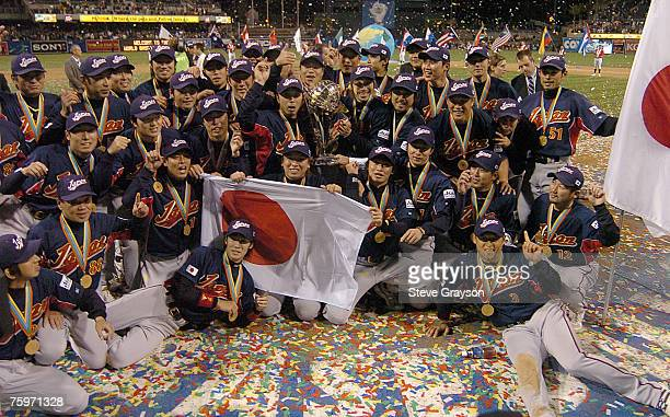 Team Japan poses for photos it's victory over Cuba in the Championship Game of the of the 2006 World Baseball Classic at PETCO Park in San Diego...