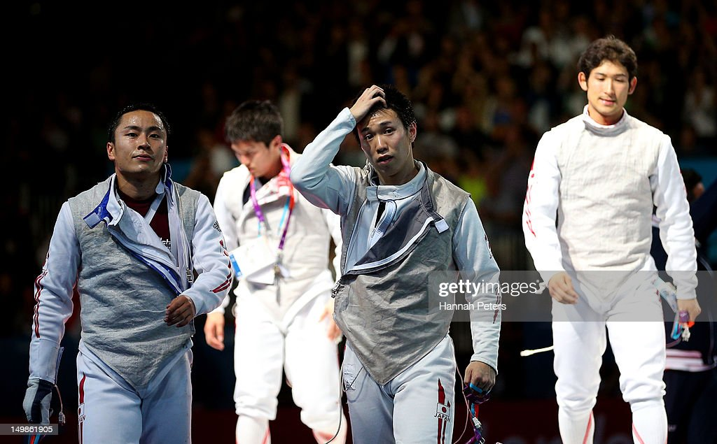 Team Japan reacts after losing the gold medal match 45-39 to Italy in the Men's Foil Team Fencing finals on Day 9 of the London 2012 Olympic Games at ExCeL on August 5, 2012 in London, England.