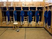 Team jerseys hanging in locker room