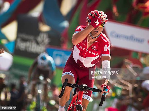 Team Katusha's Russian cyclist Sergey Lagutin celebrates winning as he crosses the finish line during the 8th stage of the 71st edition of 'La...