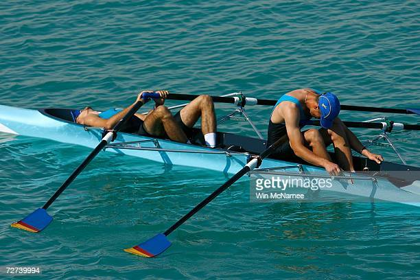 Team Kazakhstan reacts to placing fourth in the Men's Lightweight Double Sculls Rowing Competition during the 15th Asian Games Doha 2006 at the West...