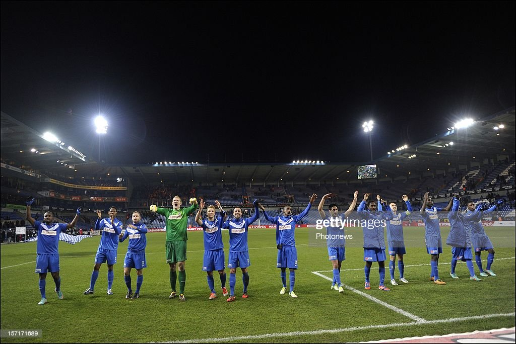 Team KRC Genk celebrates the victory after the Cofidis Cup 1/8 final match between KRC Genk and Standard Liege on November 29, 2012 in Genk , Belgium.