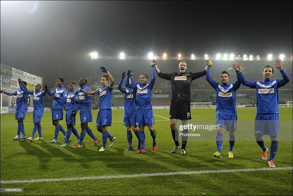 Team KRC Genk with Benji De Ceulaer, Julien Gorius and Kristof Van Hout of KRC Genk celebrates the 0 - 5 victory after the Cofidis Cup 1/4 final away match between SV Zulte Waregem and KRC Genk in the Regenboog stadium on December 13, 2012 in Waregem, Belgium.