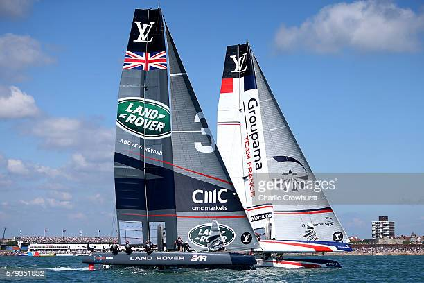 Team Land Rover BAR skippered by Sir Ben Ainslie battle race side by side with Groupama Team France skippered by Franck Cammas during day two of the...