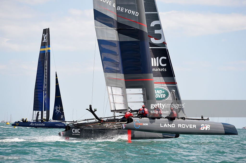 Team Land Rover BAR, skippered by Sir Ben Ainslie races with Team Artemis Racing, skippered by Nathan Outteridge (L) during the official race on Day Three of the Louis Vuitton America's Cup World Series on July 25, 2015 in Portsmouth, England.