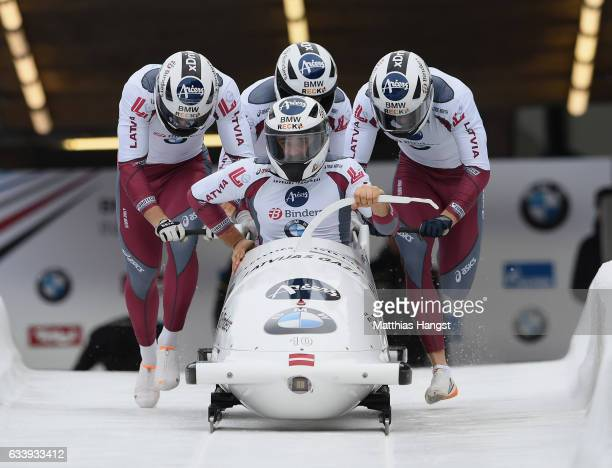 Team Latvia with pilot Oskars Kibermanis compete during the first run of the 4man Bobsleigh BMW IBSF World Cup at Olympiabobbahn Igls on February 5...