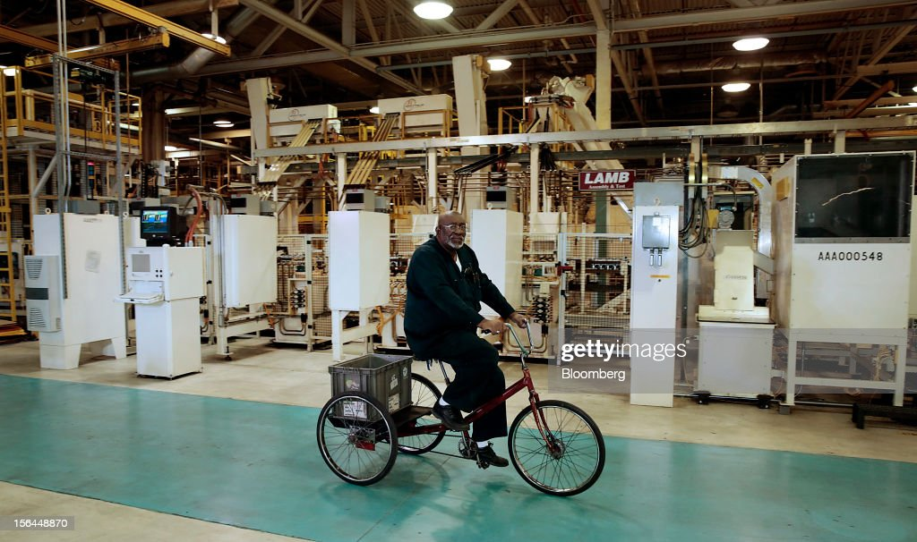 Team leader Charlie Kelly rides a bike to listen to Sergio Marchionne, chief executive officer of Fiat SpA and Chrysler Group LLC, speak during an event at the Chrysler Mack I Engine Plant in Detroit, Michigan, U.S., on Thursday, Nov. 15, 2012. Chrysler Group LLC, the automaker planning to merge with Fiat SpA, will add 1,250 workers at three U.S. plants to boost output of pickups and engines. Photographer: Jeff Kowalsky/Bloomberg via Getty Images