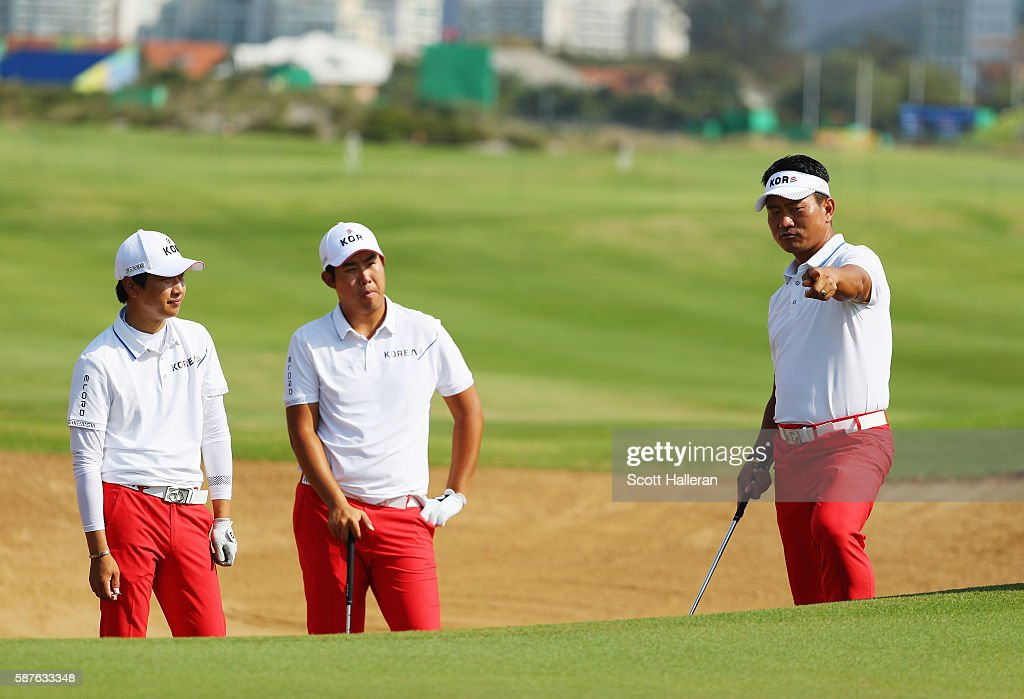 Team leader K.J. Choi (R) work in a bunker with Byeong-Hun An and Jeung-hun Wang of Korea during a practice round on Day 4 of the Rio 2016 Olympic Games at Olympic Golf Course on August 9, 2016 in Rio de Janeiro, Brazil.