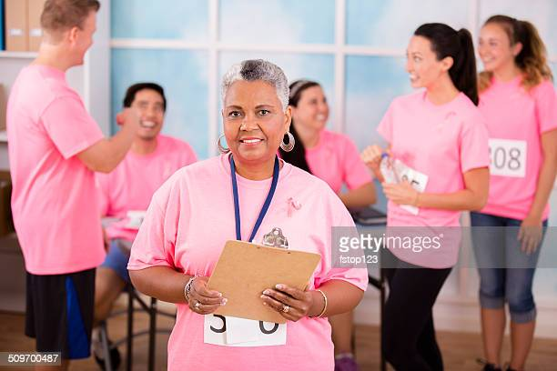 Team leader organizes Breast Cancer Awareness charity event.