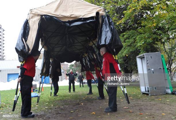EMAT team leader Steve Urszenyi directs the placement of the tent The Ontario EMAT team went to Moss Park on Thursday afternoon to set up an all...