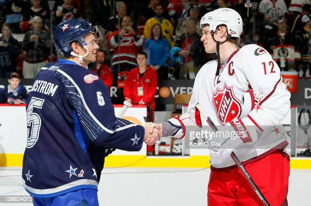 Team Lidstrom captain Nicklas Lidstrom of the Detroit Red Wings shakes hands with Team Staal captain Eric Staal of the Carolina Hurricanes after Team...