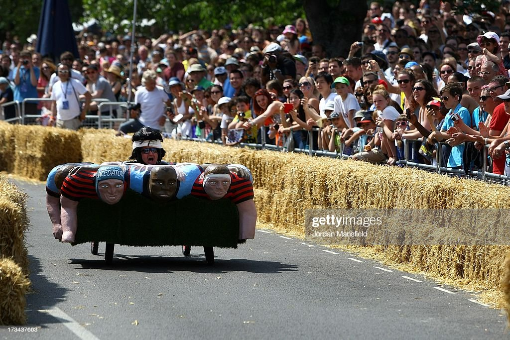 A team makes their way down the course during the Red Bull Soapbox Race at Alexandra Palace on July 14, 2013 in London, England. The Red Bull Soapbox Race returned to London after nine years and encourages competitors to build and race their own homemade soapboxes down a hill.