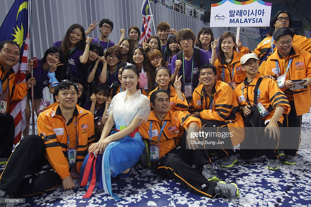 Team Malaysia and volunteers celebrate during the closing ceremony of the 4th Asian Indoor & Martial Arts Games at Incheon Samsan World Gymansium on July 6, 2013 in Incheon, South Korea.