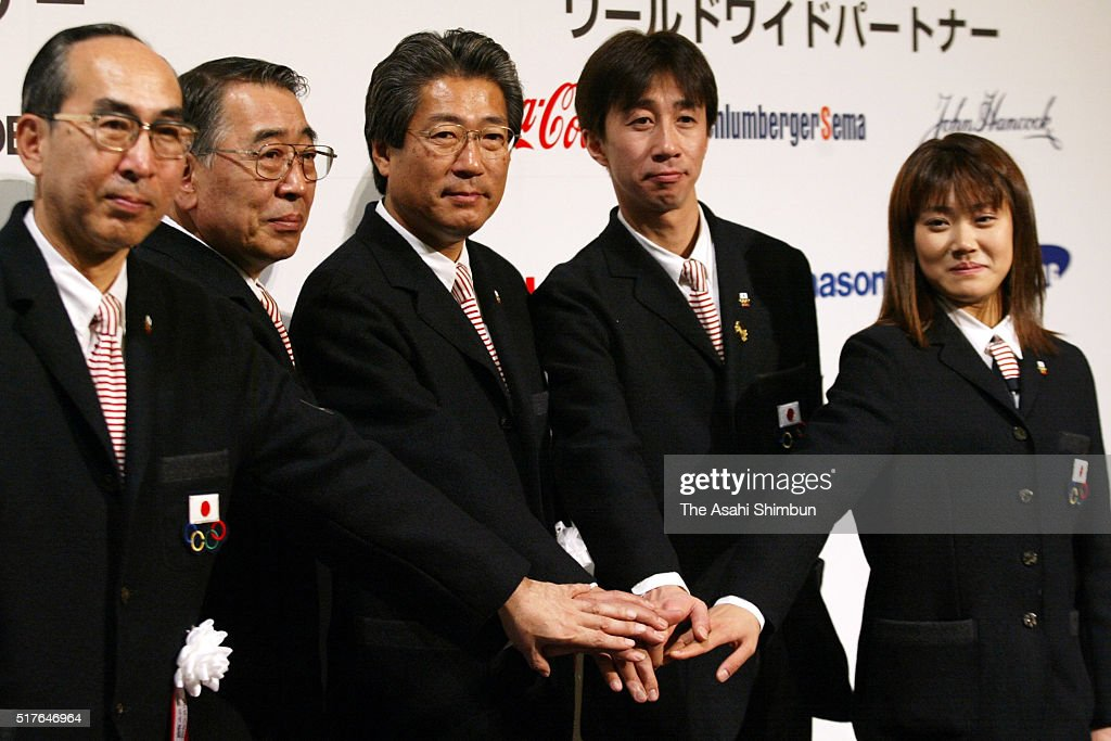 Team manager Kanji Kameoka, vice chef de mission Mitsunori Ikegami, chef de mission <a gi-track='captionPersonalityLinkClicked' href=/galleries/search?phrase=Tsunekazu+Takeda&family=editorial&specificpeople=2574573 ng-click='$event.stopPropagation()'>Tsunekazu Takeda</a>, captain Masahiko Harada and flag bearer Yoshie Onda pose for photographs during the Salt Lake Winter Olympics Japan Delegation Sending Off Ceremony on February 2, 2002 in Tokyo, Japan.