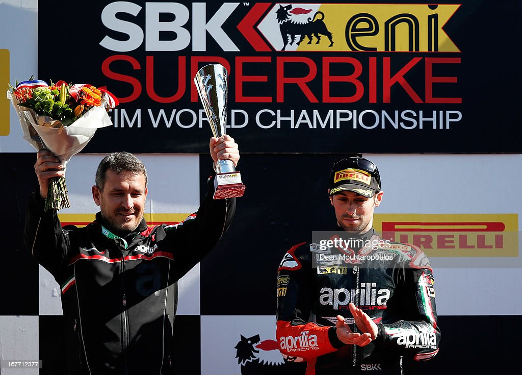 Team Manager, Luigi Dall'Igna (L) and <a gi-track='captionPersonalityLinkClicked' href=/galleries/search?phrase=Eugene+Laverty&family=editorial&specificpeople=4253466 ng-click='$event.stopPropagation()'>Eugene Laverty</a> (#58) of Ireland on the Aprilia RSV4 for the Aprilia Racing Team celebrate winning the World Superbikes Race 2 at TT Circuit Assen on April 28, 2013 in Assen, Netherlands.