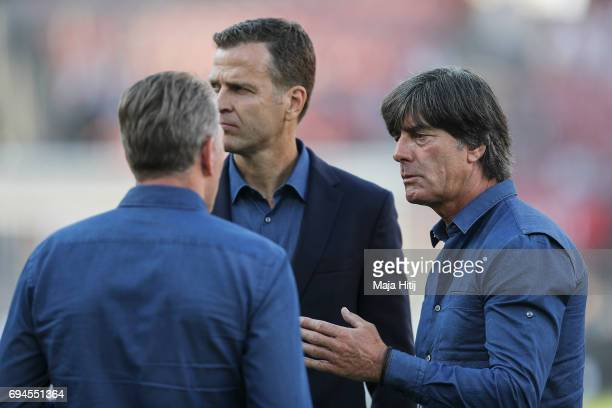 Team manager of the German national team Oliver Bierhoff and head coach Joachim Loew of Germany stand prior the FIFA 2018 World Cup Qualifier between...