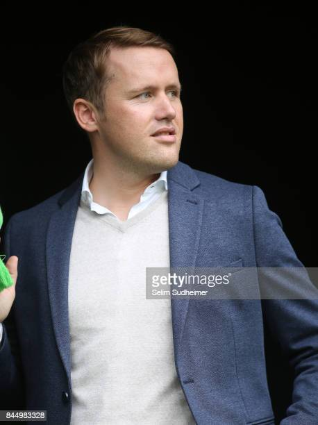 team manager Olaf Rebbe of VfL Wolfsburg looks on prior to the Bundesliga match between VfL Wolfsburg and Hannover 96 at Volkswagen Arena on...
