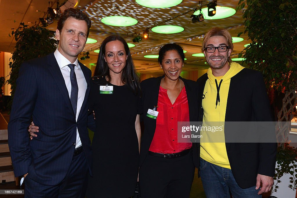 DFB team manager <a gi-track='captionPersonalityLinkClicked' href=/galleries/search?phrase=Oliver+Bierhoff&family=editorial&specificpeople=213661 ng-click='$event.stopPropagation()'>Oliver Bierhoff</a>, Bettina Haussmann, <a gi-track='captionPersonalityLinkClicked' href=/galleries/search?phrase=Steffi+Jones+-+Soccer+Player&family=editorial&specificpeople=226998 ng-click='$event.stopPropagation()'>Steffi Jones</a> and Comedian Matze Knop pose for a photo after the DFB Bundestag opening ceremony at NCC Nuremberg on October 24, 2013 in Nuremberg, Germany.