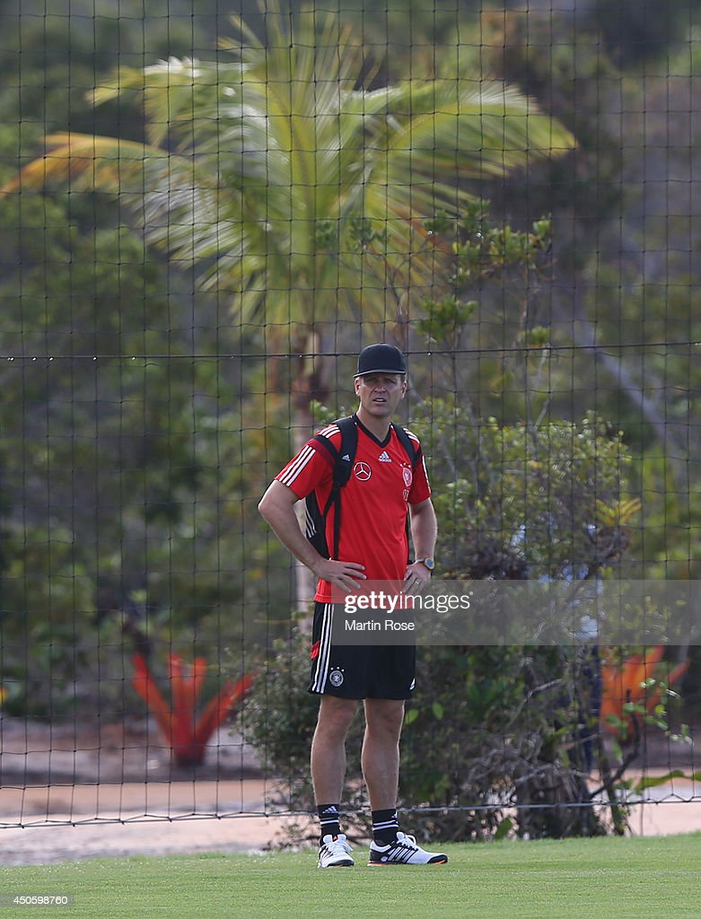 Team manager <a gi-track='captionPersonalityLinkClicked' href=/galleries/search?phrase=Oliver+Bierhoff&family=editorial&specificpeople=213661 ng-click='$event.stopPropagation()'>Oliver Bierhoff</a> looks on during the German National team training at Campo Bahia on June 14, 2014 in Santo Andre, Brazil.