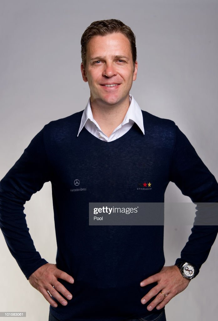 Team manager <a gi-track='captionPersonalityLinkClicked' href=/galleries/search?phrase=Oliver+Bierhoff&family=editorial&specificpeople=213661 ng-click='$event.stopPropagation()'>Oliver Bierhoff</a> poses during the official team photocall of the German FIFA 2010 World Cup squad on June 3, 2010 in Frankfurt am Main, Germany.
