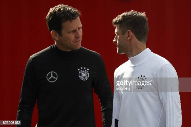 Team manager Oliver Bierhoff talks to Thomas Mueller during training of German national team ahead of the FIFA World Cup qualification match 2018...