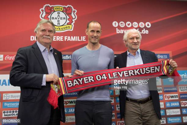 Team manager Rudi Voeller of Bayer Leverkusen the newly appointed head coach Heiko Herrlich and chairman Michael Schade pose after a press conference...
