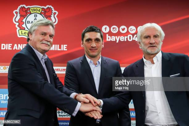 Team manager Rudi Voeller of Leverkusen Tayfun Korkut the newly appointed head coach of Bayer Leverkusen and Chairman Michael Schade of Leverkusen...