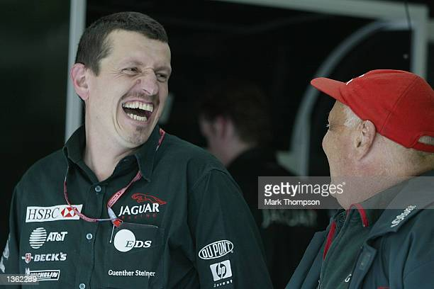 Team Managing Director Guenther Steiner enjoys a joke with Jaguar Racing Team Principal Niki Lauda during qualifying for the FIA Formula One Belgian...