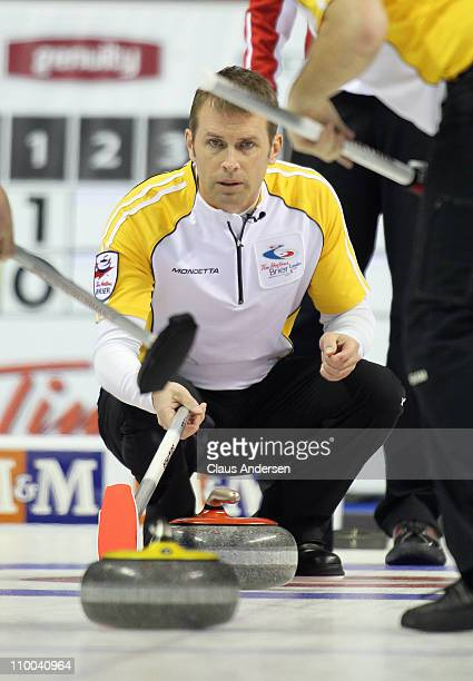 Team Manitoba skip Jeff Stoughton watches a rock curl towards him in the 1 vs 2 Page Playoff game against Team Newfoundland/Labrador in the 2011 Tim...