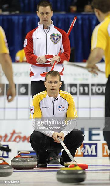 Team Manitoba skip Jeff Stoughton watches a shot curl towards him in the 1 vs 2 Page Playoff game against Team Newfoundland/Labrador in the 2011 Tim...