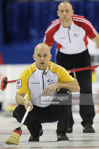 Team Manitoba third Jon Mead watches a rock curl in the 1 vs 2 Page Playoff game against Team NewFoundland/Labrador in the 2011 Tim Hortons Brier...