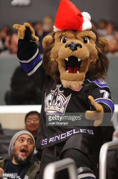 Team mascot Bailey of the Los Angeles Kings sports his holiday hat while cheering with fans during a game against the St Louis Blues on December 11...