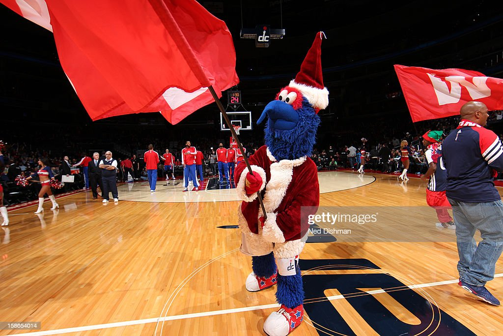 Team Mascot G-Wiz of the Washington Wizards hypes up the crowd pre-game against the Detroit Pistons during the game at the Verizon Center on December 22, 2012 in Washington, DC.