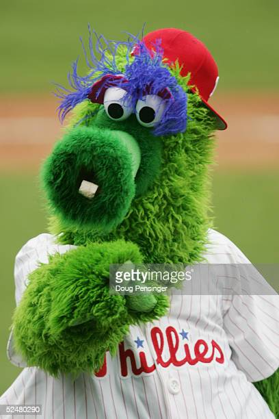 Team mascot The Phillie Phanatic performs as the Philadelphia Phillies play against the Detroit Tigers during MLB Spring Training action at the...