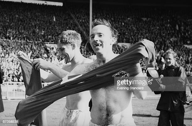 Team mates Alan Ball left and Nobby Stiles celebrate after England's victory in the 1966 World Cup final at Wembley 30th July 1966