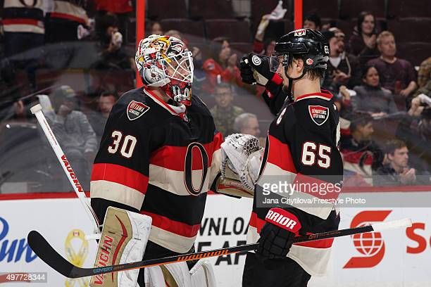 Team mates Andrew Hammond and Erik Karlsson of the Ottawa Senators celebrate their win during an NHL game against the Vancouver Canucks at Canadian...