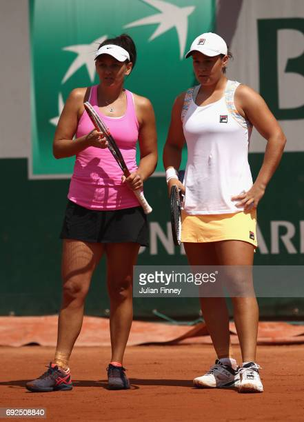 Team mates Casey Dellacqua and Ashleigh Barty of Australia speak during ladies doubles match against Daria Gavrilova of Australia and Anastasia...