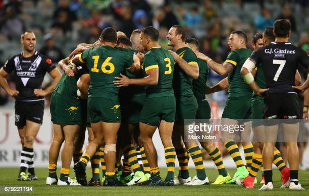 Team mates celebrate the try of Jake Trbojevic of Australia during the ANZAC Test match between the Australian Kangaroos and the New Zealand Kiwis at...