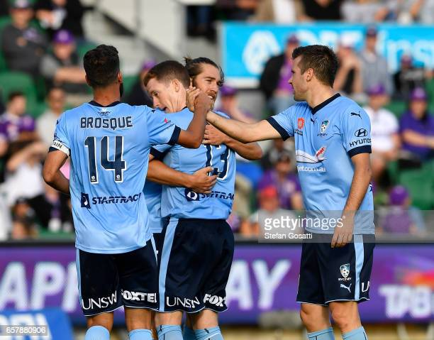 Team mates celebrate with Brandon O'Neill of Sydney FC after scoring during the round 24 ALeague match between Perth Glory and Sydney FC at nib...