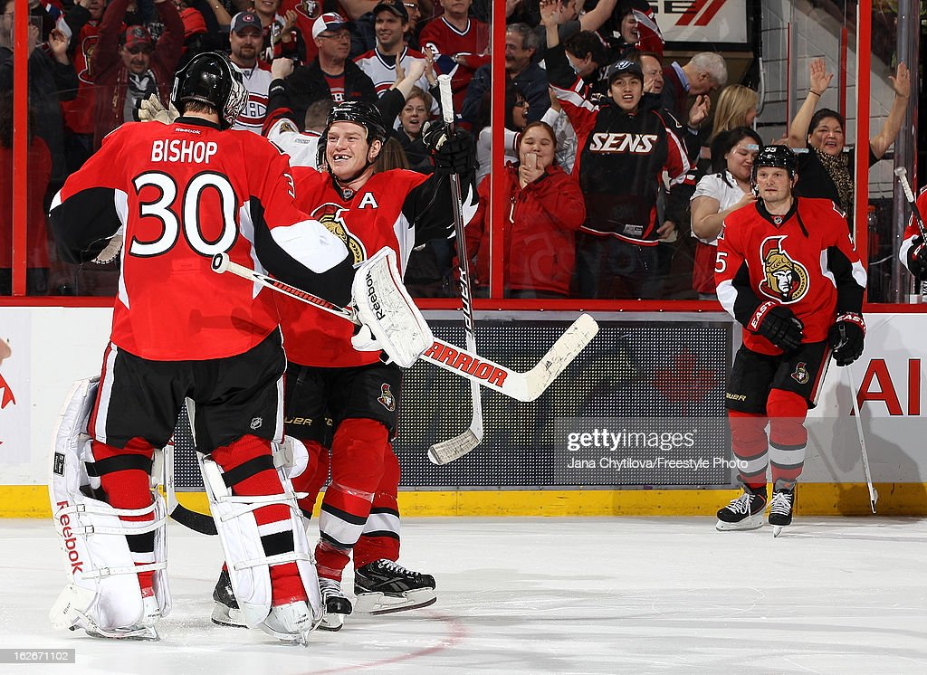 Team mates Chris Neil #25 and <a gi-track='captionPersonalityLinkClicked' href=/galleries/search?phrase=Ben+Bishop&family=editorial&specificpeople=700137 ng-click='$event.stopPropagation()'>Ben Bishop</a> #30 of the Ottawa Senators celebrate their shootout win against the Montreal Canadiens, during an NHL game at Scotiabank Place on February 25, 2013 in Ottawa, Ontario, Canada.