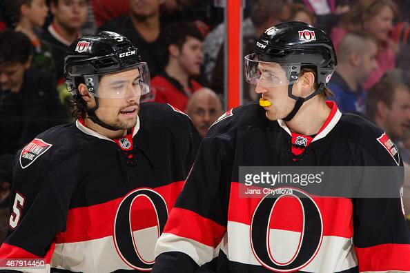Team mates Cody Ceci and Patrick Wiercioch of the Ottawa Senators chat during a game against the New York Rangers at Canadian Tire Centre on March 26...