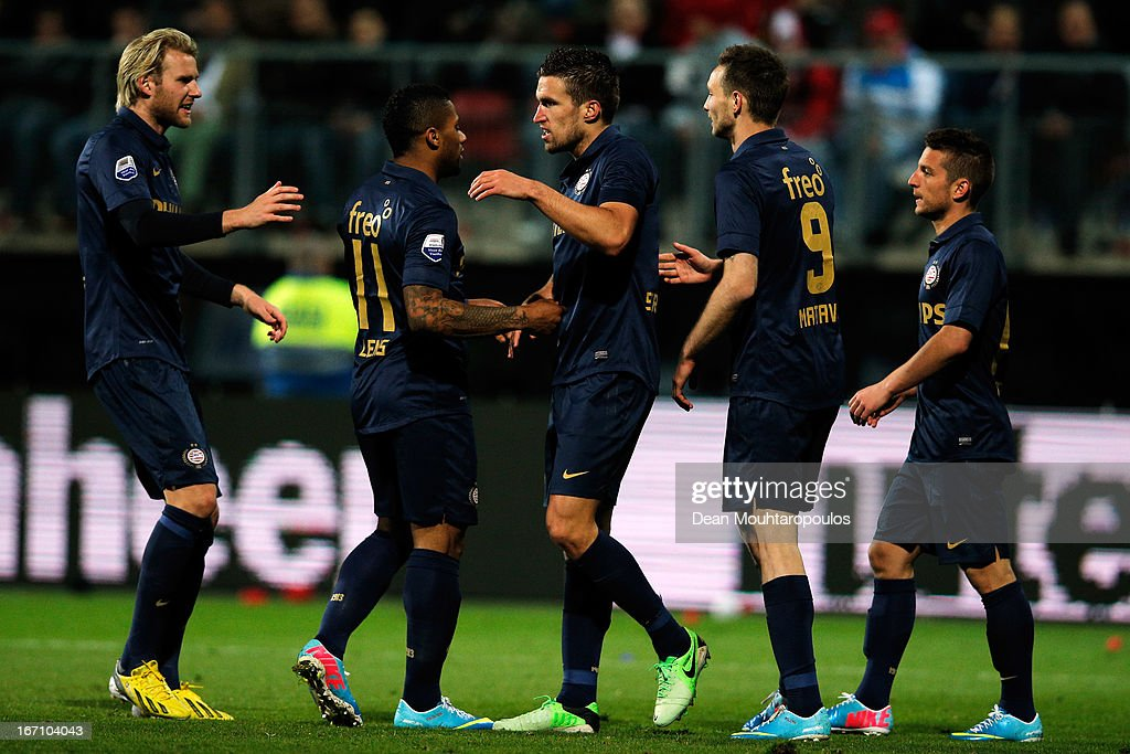 Team mates congratulate <a gi-track='captionPersonalityLinkClicked' href=/galleries/search?phrase=Kevin+Strootman&family=editorial&specificpeople=5566501 ng-click='$event.stopPropagation()'>Kevin Strootman</a> (C) of PSV for setting up a goal for <a gi-track='captionPersonalityLinkClicked' href=/galleries/search?phrase=Dries+Mertens&family=editorial&specificpeople=6524919 ng-click='$event.stopPropagation()'>Dries Mertens</a> (R) during the Eredivisie match between AZ Alkmaar and PSV Eindhoven at the AFAS Stadium on April 20, 2013 in Alkmaar, Netherlands.