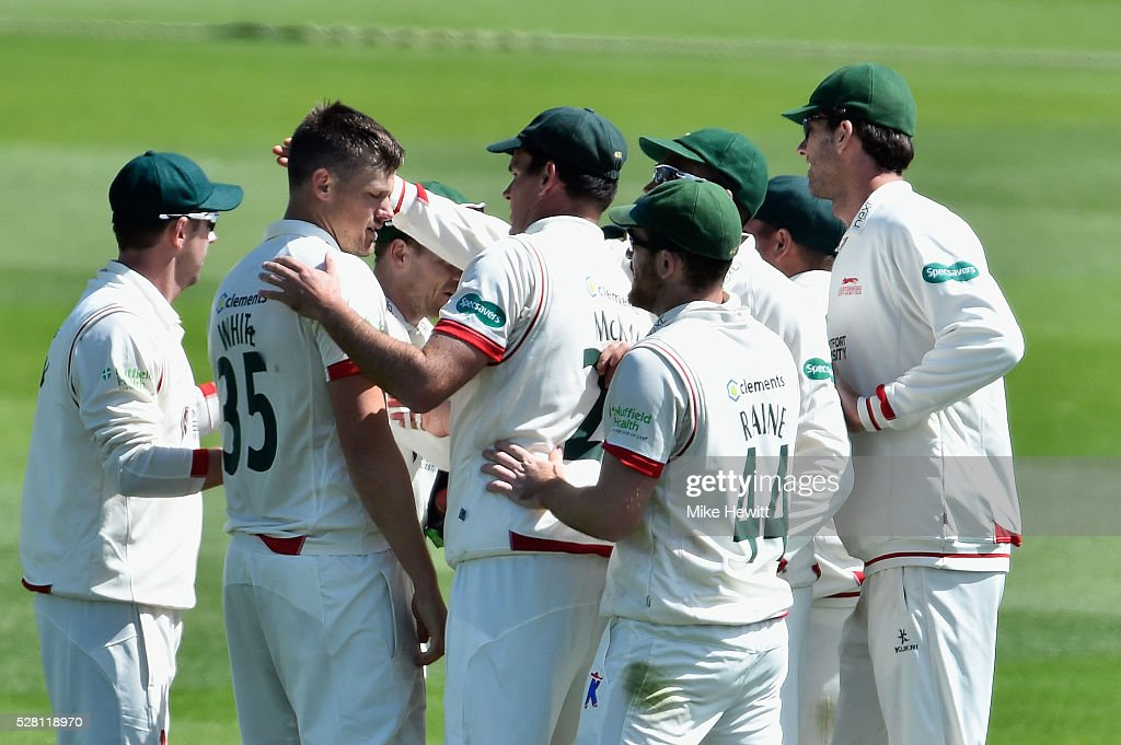 Team mates congratulate Wayne White of Leicestershire for taking the wicket of Ed Joyce during the Specsavers County Championship Division Two match between Sussex and Leicestershire on May 04, 2016 in Hove, England.