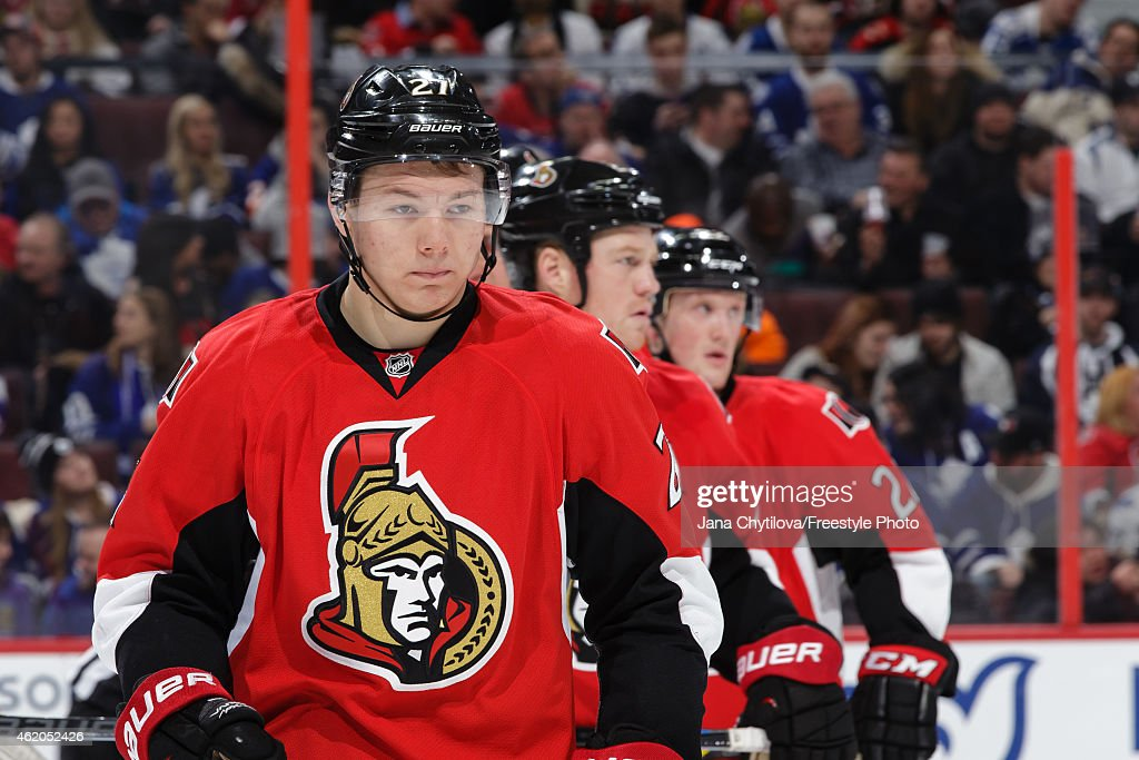 Team mates Curtis Lazar 25n and Erik Condra of the Ottawa Senators looks on during a stoppage in play against the Toronto Maple Leafs at Canadian...
