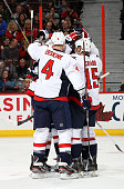 Team mates John Erskine and Joey Crabb of the Washington Capitals celebrate a first period goal during an NHL game against the Ottawa Senators at...