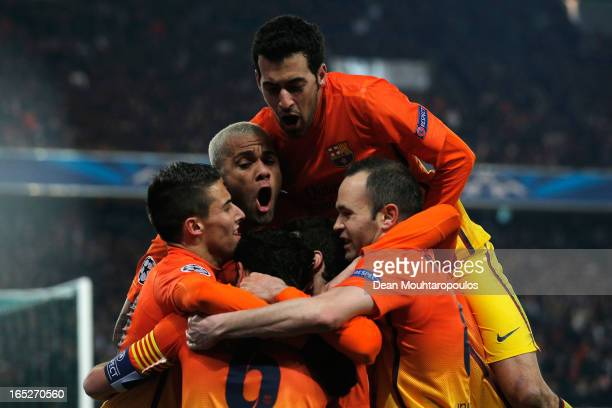 Team mates jump on Xavi of Barcelona as they celebrate scoring a penalty for the teams second goal during the UEFA Champions League Quarter Final...